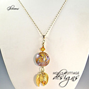 Artisan crafted lampwork pendant on gold plated chain