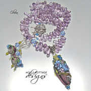 SOLD Artisan crafted lampwork pendant on amethyst necklace with earrings