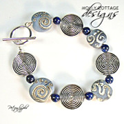 Artisan crafted lampwork & lapis lazuli bead bracelet