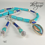 Artisan crafted turquoise & lapis necklace with rainbow calsilica pendant