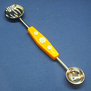 Orange Plastic Handle White Flowers Melon Baller