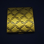 Volupte Gold Tone Mirrored Compact Ribbon Design Lid