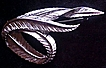 "Monet (Signed) Silver Toned ""Twisted Feather"" Design Brooch, circa 1950-60s"