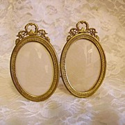 SOLD Antique Bronze Double Picture Frame Laurel Wreath Tops Easel Back
