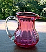 Hand Blown Miniature Cranberry Pitcher with Reeded Handle