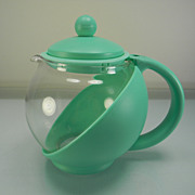Unusual Vintage Tea Pot with Green Plastic Holder