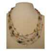 Multiple strand Illusion necklace with silver and gold-filled disks, Swarovski crystals, and facetted black sapphire beads..