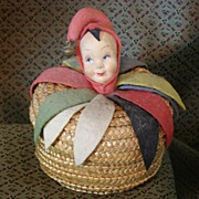Unique Molded cloth Jester doll head on a basket