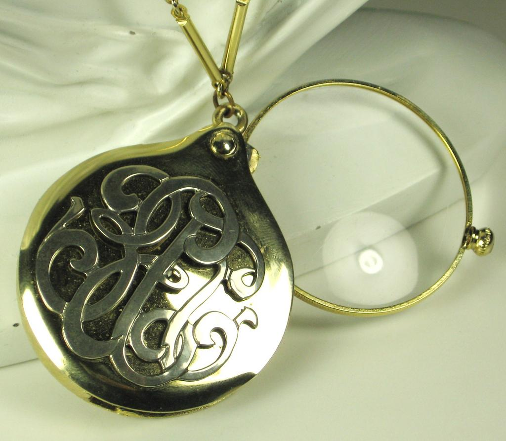 hattie carnegie magnifying glass necklace from