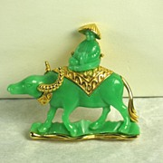 Hattie Carnegie Green Plastic Oriental Man on Steer Pin