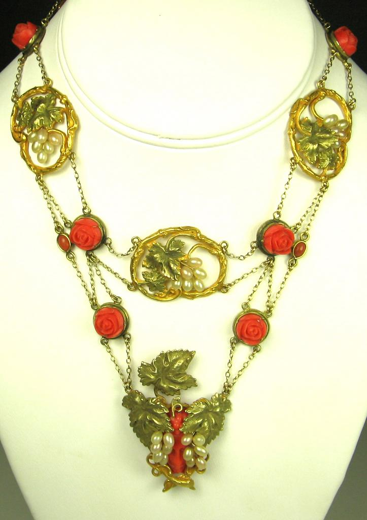 Item ID: 1510- Coral Floral Necklace In Shop's Backroom