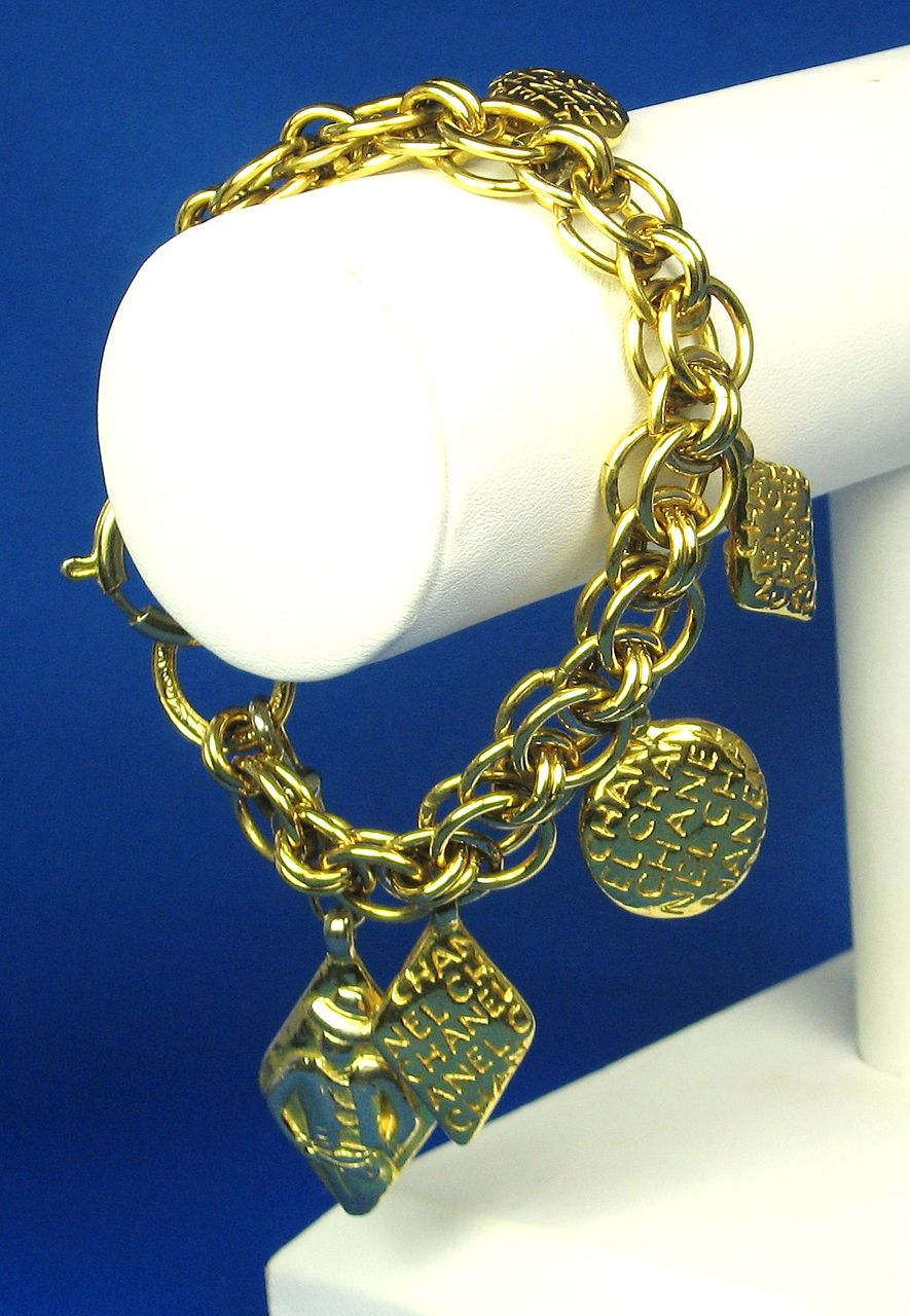 1980s Gold Tone Metal Charm Bracelet Marked Chanel
