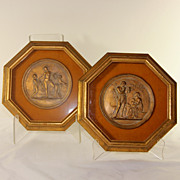 Pair of octagonal framed gilded and framed classical Roman plaques