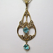 14 K Gold Lavaliere with Blue Zircons and Seed Pearls on 14 K Gold Chain, circa 1920