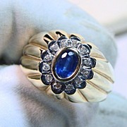 Sapphire Surrounded by Diamonds in a 14k Yellow Gold Ring