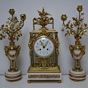 A French period 1880 marble and bronze 4-glass garniture.