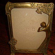 Art Nouveau brass stand up mirror frame. Circa 1910.