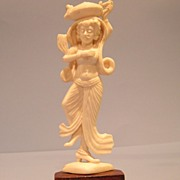 Ivory statue of a woman carrying a pot on her head. Indian. c1900
