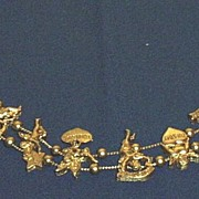 SOLD Hearts, Cupid, And Days Of The Week Metal Charm Bracelet Gold Toned  Two Chains
