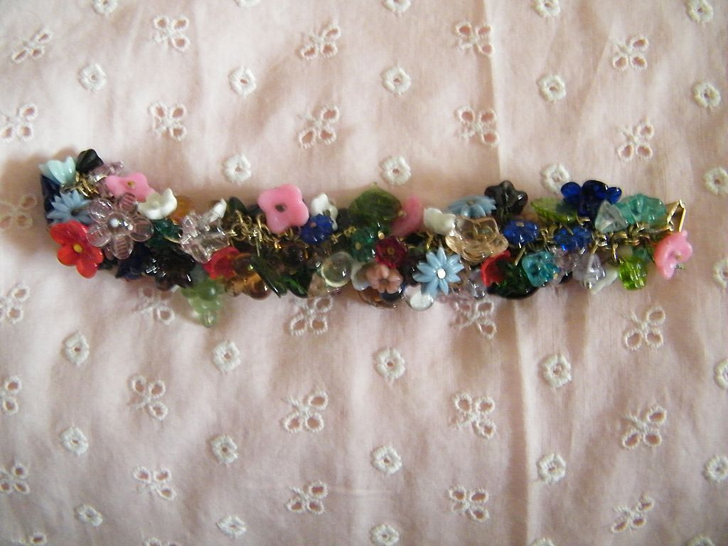 CHA-CHA Bracelet Packed With Glass Mini Floral Charms In Many Colors On Goldtone Chain..Excellent Condition!