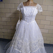 Designer Wedding Gown Of Tulle With Embroidery..Multi-Layered..Square Neck..Short Sleeves..Mat