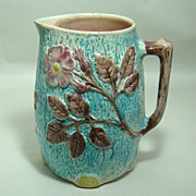 Antique English Majolica Pitcher with Flower Sprays Against Tree Bark Motif � Circa: Late 1800