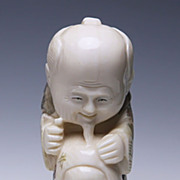 Japanese Ivory Netsuke - Face Inside Drum With Man Above
