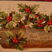 Early 1900's Log Filled With Holly Leaves & Berries: Embossed Christmas Postcard