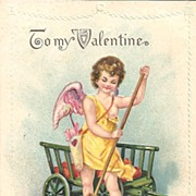 VALENTINE Post Card With Cupid Raking Up Red Hearts