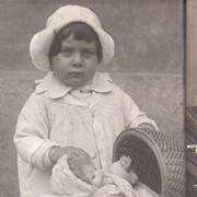 Photo Postcard~Chubby Little Girl~Doll in a Buggy