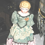 Hand Painted China Head Doll in Very Old Dress.