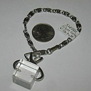 Silver-colored Bracelet with Ice Tong and Large Ice Block Dangle
