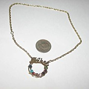 Mother's Pendant on a Gold-Colored Chain