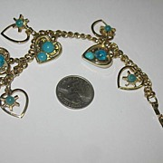 Unmarked But Fun Gold-tone Bracelet with Hanging Hearts and Blue Beads