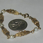 Gold-Tone Bracelet with Faux Pearls