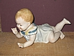 Unmarked Porcelain Boy Piano Baby