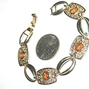 Marked Sarah Coventry Amber-colored  Rhinestone Bracelet