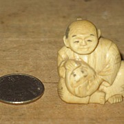 Very Small Ivory Netsuke of Man Holding Something