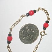 Delicate Bracelet with Gold-tone Chain with Black and Red Beads