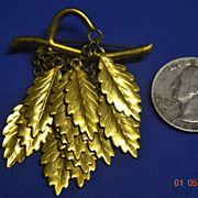 Unmarked Goldtone Hanging Leaves Pin