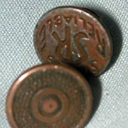 Two metal riveted buttons