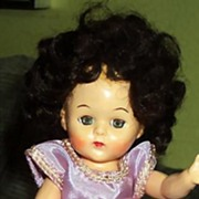 "7 1/2"" Hard Plastic 1950s Doll in Original Clothes"