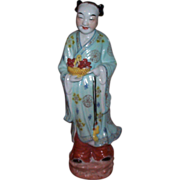 Early 20C/ Late 19C Chinese Figurine Holding Bowl in hand w/Lotus Flower