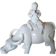 Blanc de Chine Water Buffalo with Child Playing a Flute