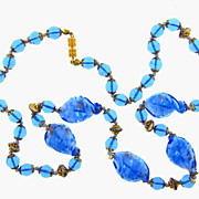 Very nice blue cased art glass bead necklace