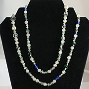 Beautiful long all glass bead necklace mix of shapes blues-greens-opaque etc