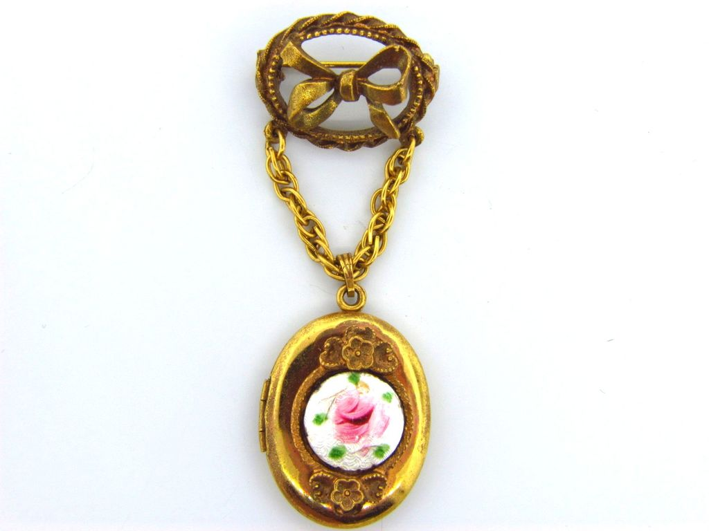 Signed Coro 2 pc. guilloche locket and bow brooch