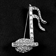 Gorgeous silver tone Musical Note with bright sparkling rhinestones as accents