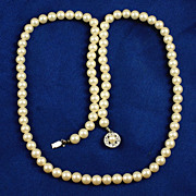 Lovely strand of imitation glass pearls off white cultura coloring