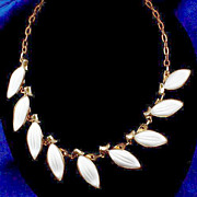 Gorgeous white molded glass leaves adjustable gold tone necklace